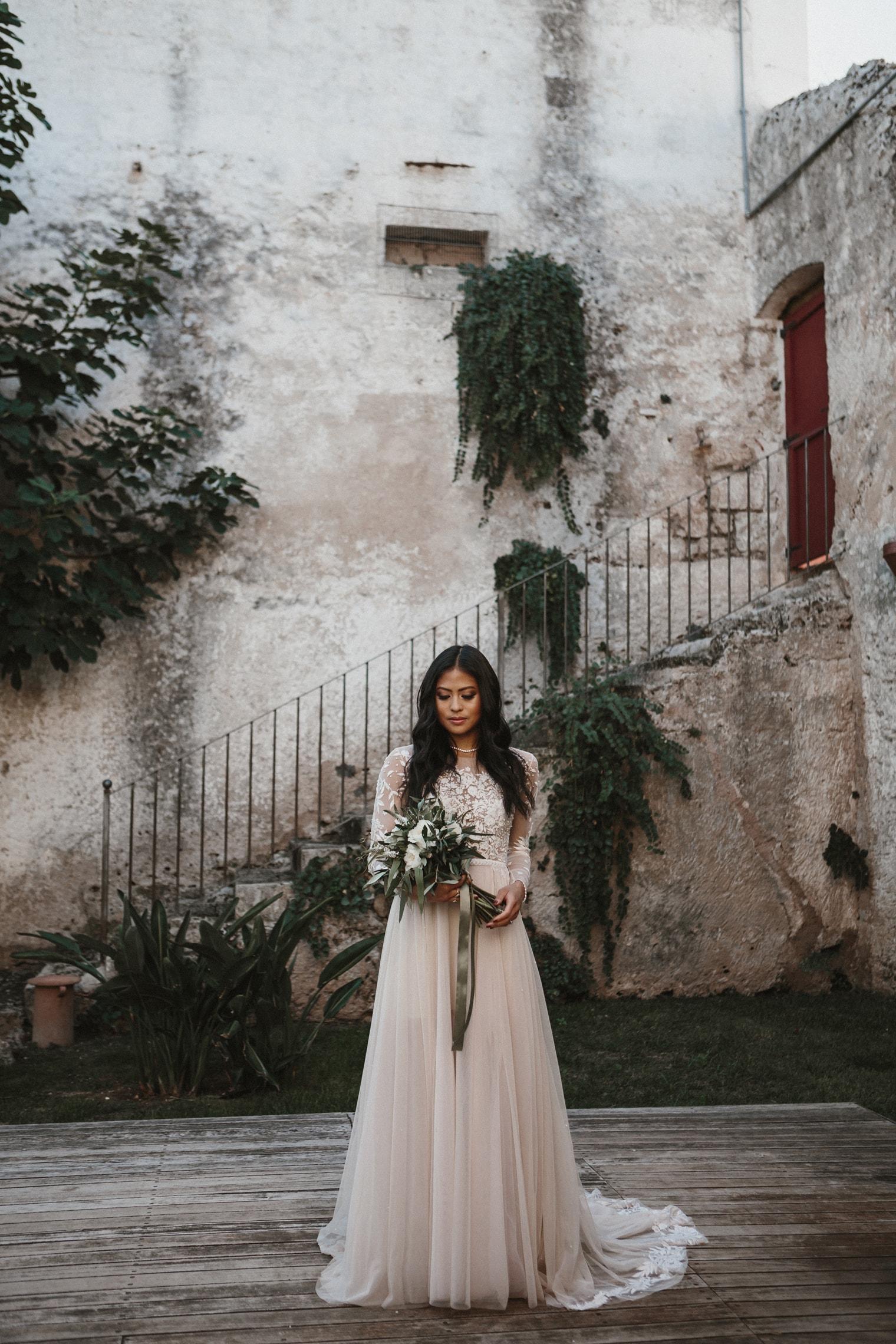 Apulian bride wearing beautiful Hermione de paula gown in italy for destination wedding