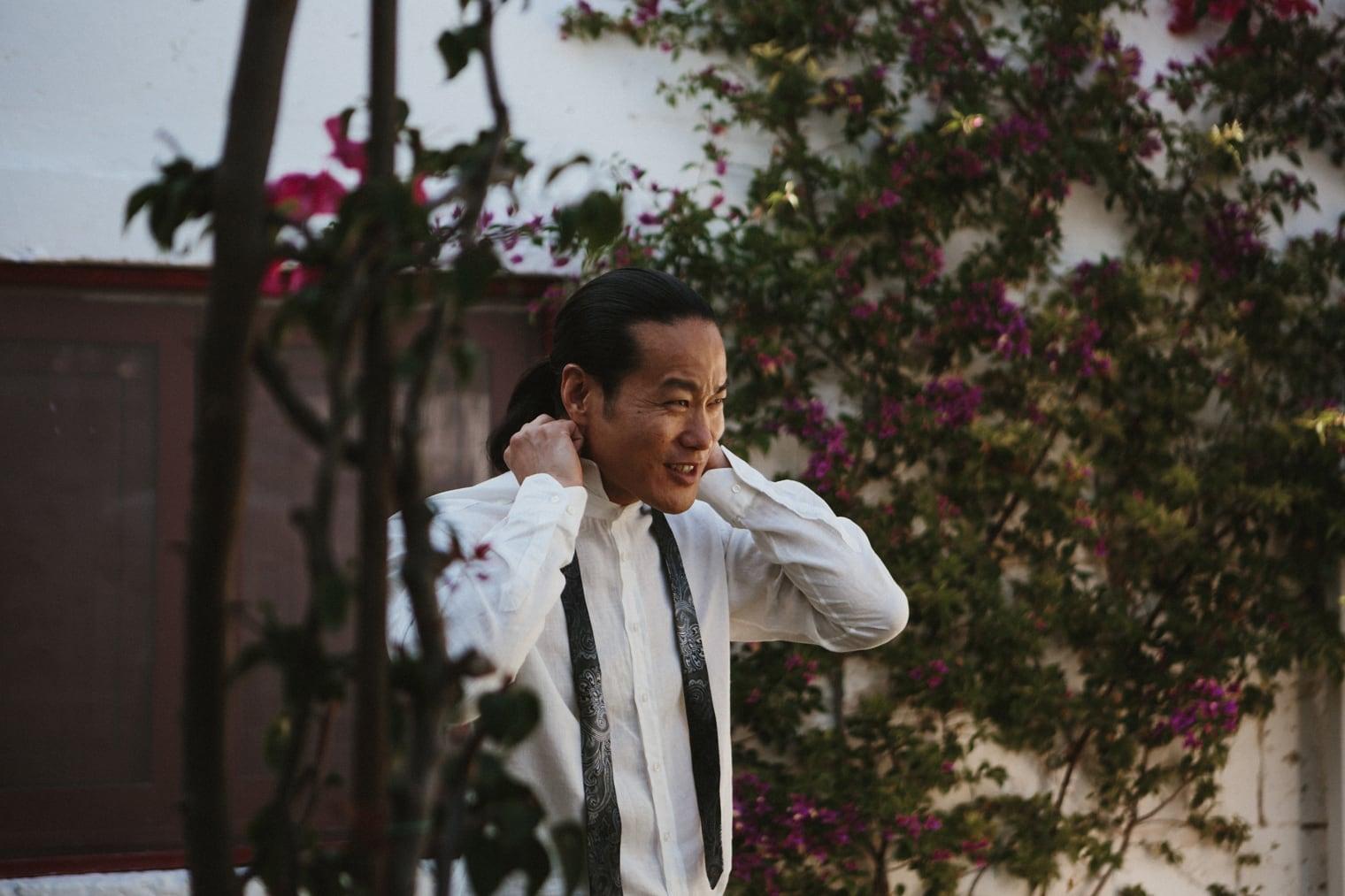 groom getting ready for italian wedding in Puglia