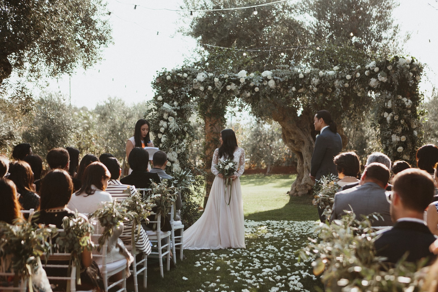 Beautiful floral arch at wedding ceremony in Puglia at masseria torre coccaro