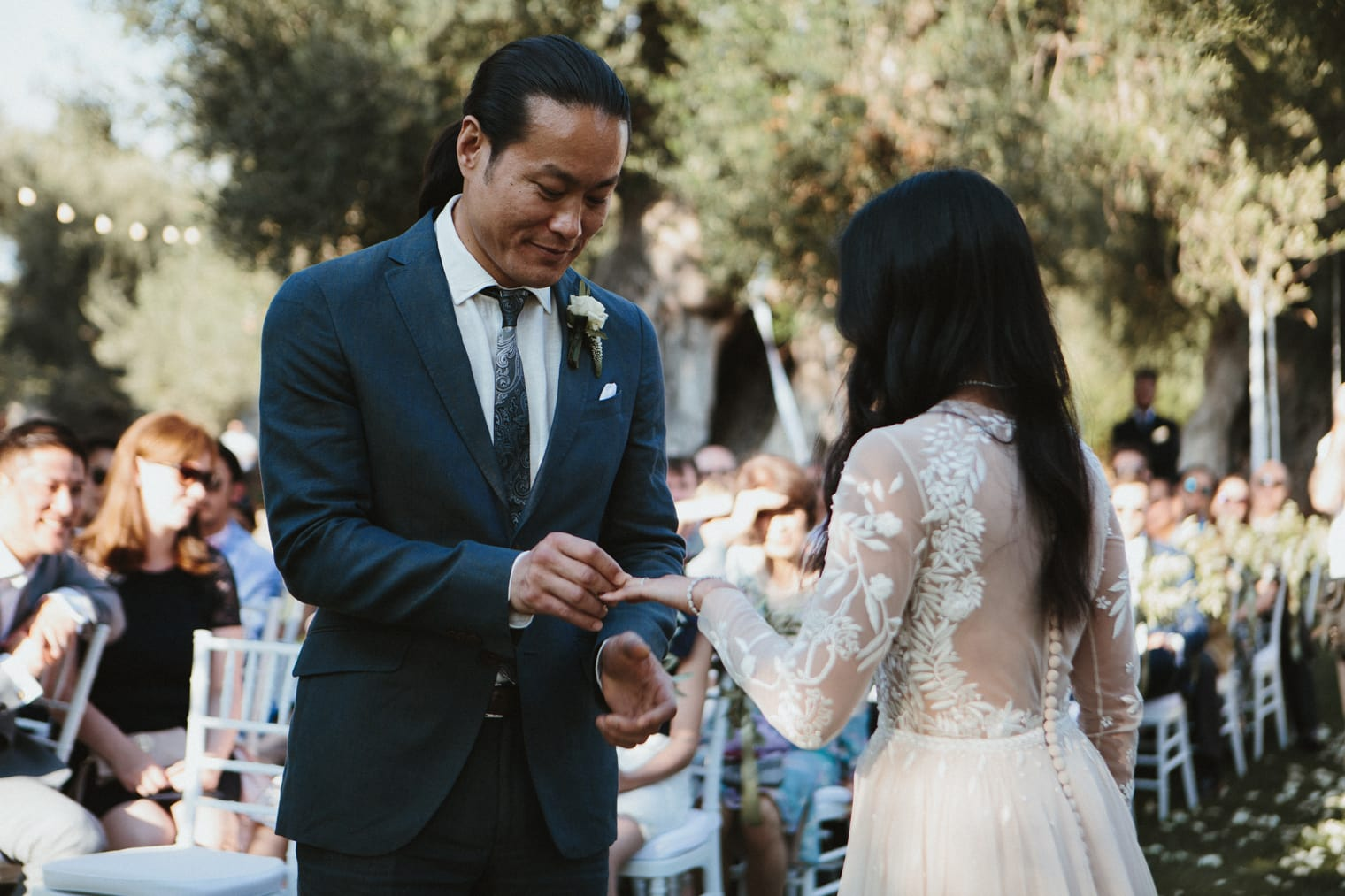 Bride and Groom exchanging rings at italian wedding ceremony at masseria torre coccaro
