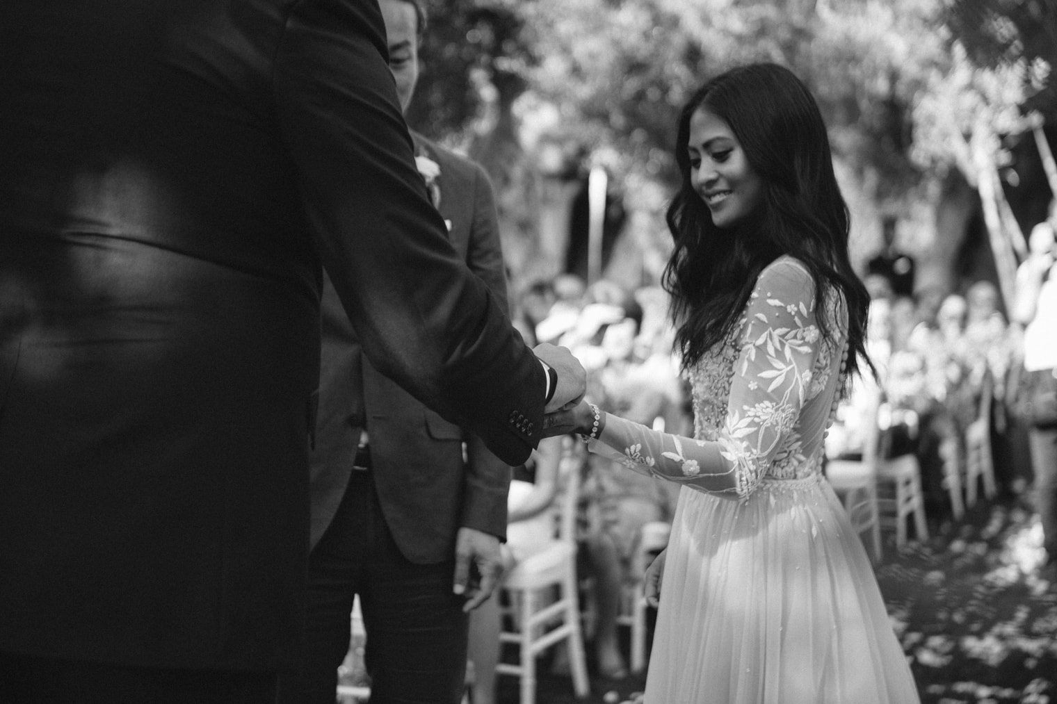 Bride and groom exchange rings at Italian wedding ceremony in Puglia
