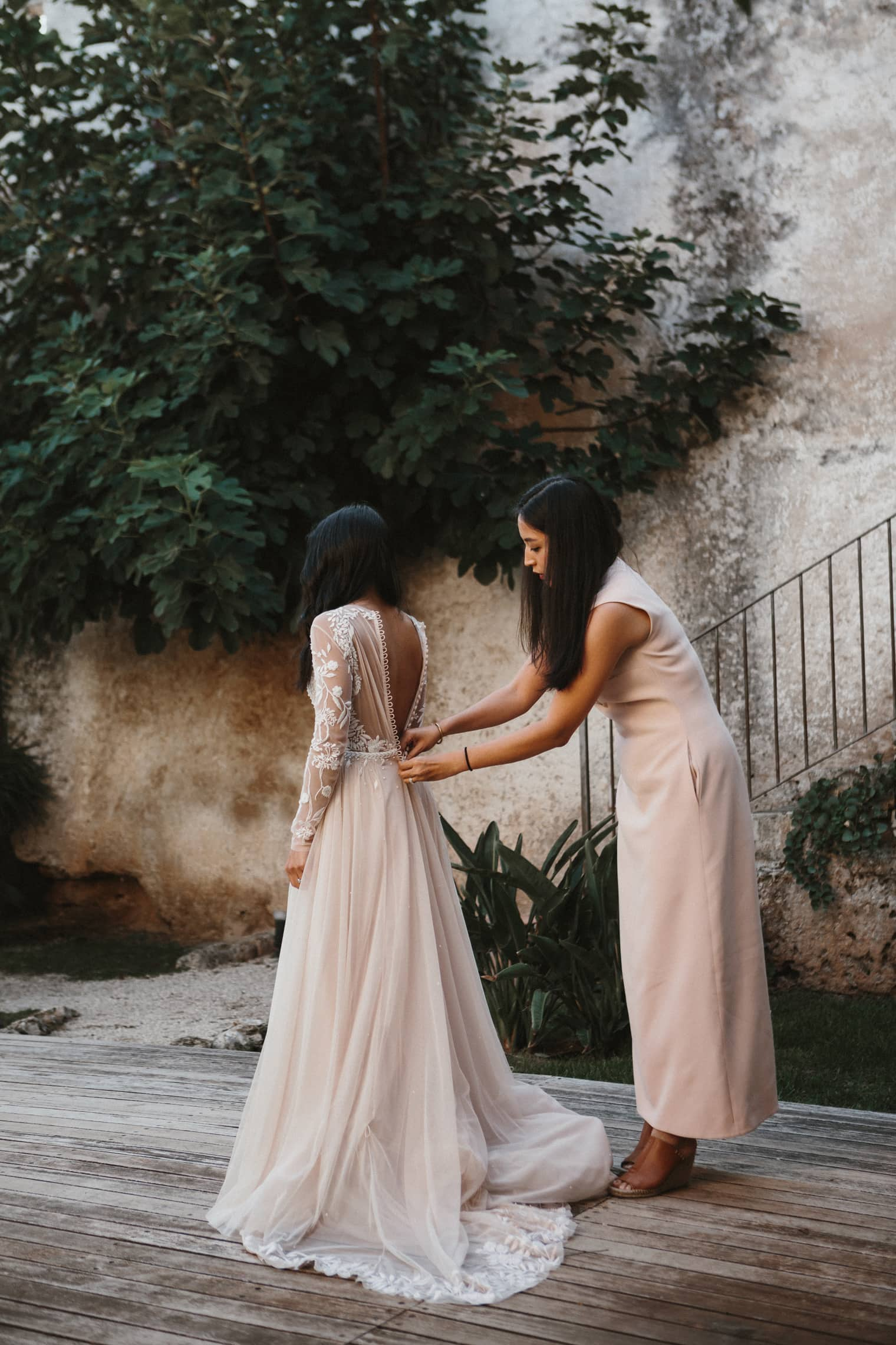 Bride wearing Hermione de Paula gown for her destination wedding in italy