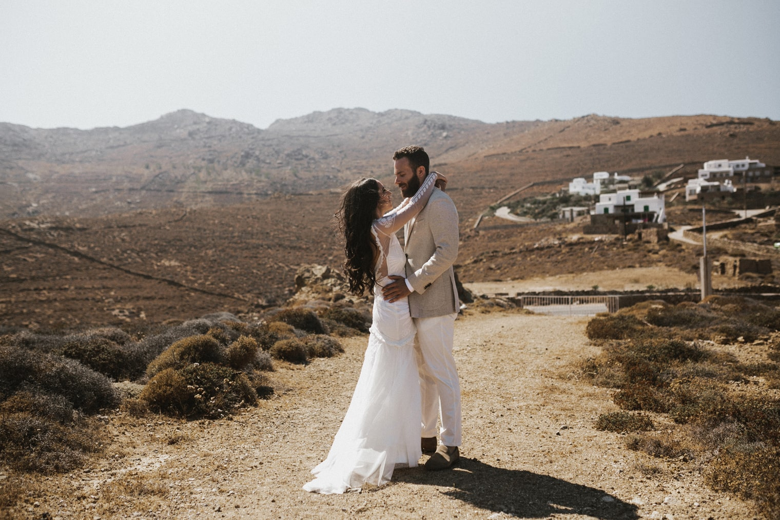 bride and groom in the sun in during their Wedding in Mykonos, Greece
