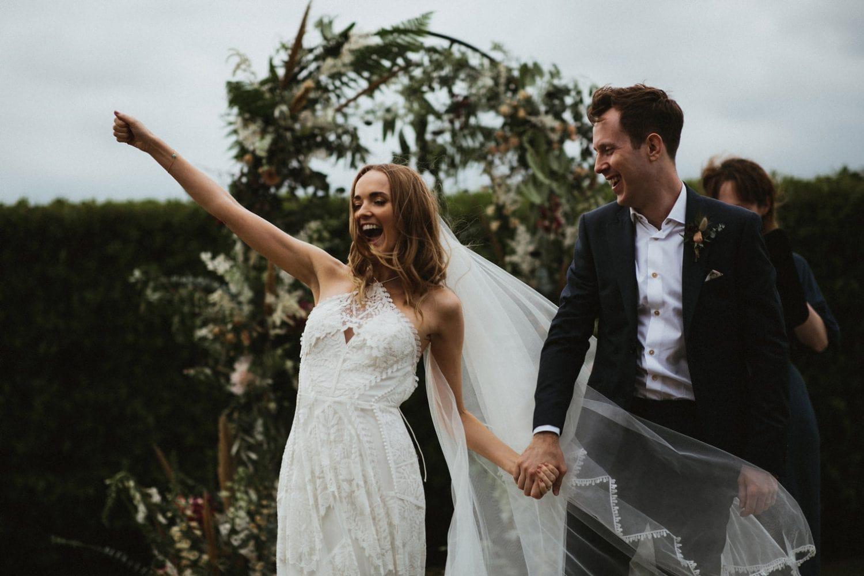 bride just married in rue de seine bridal gown