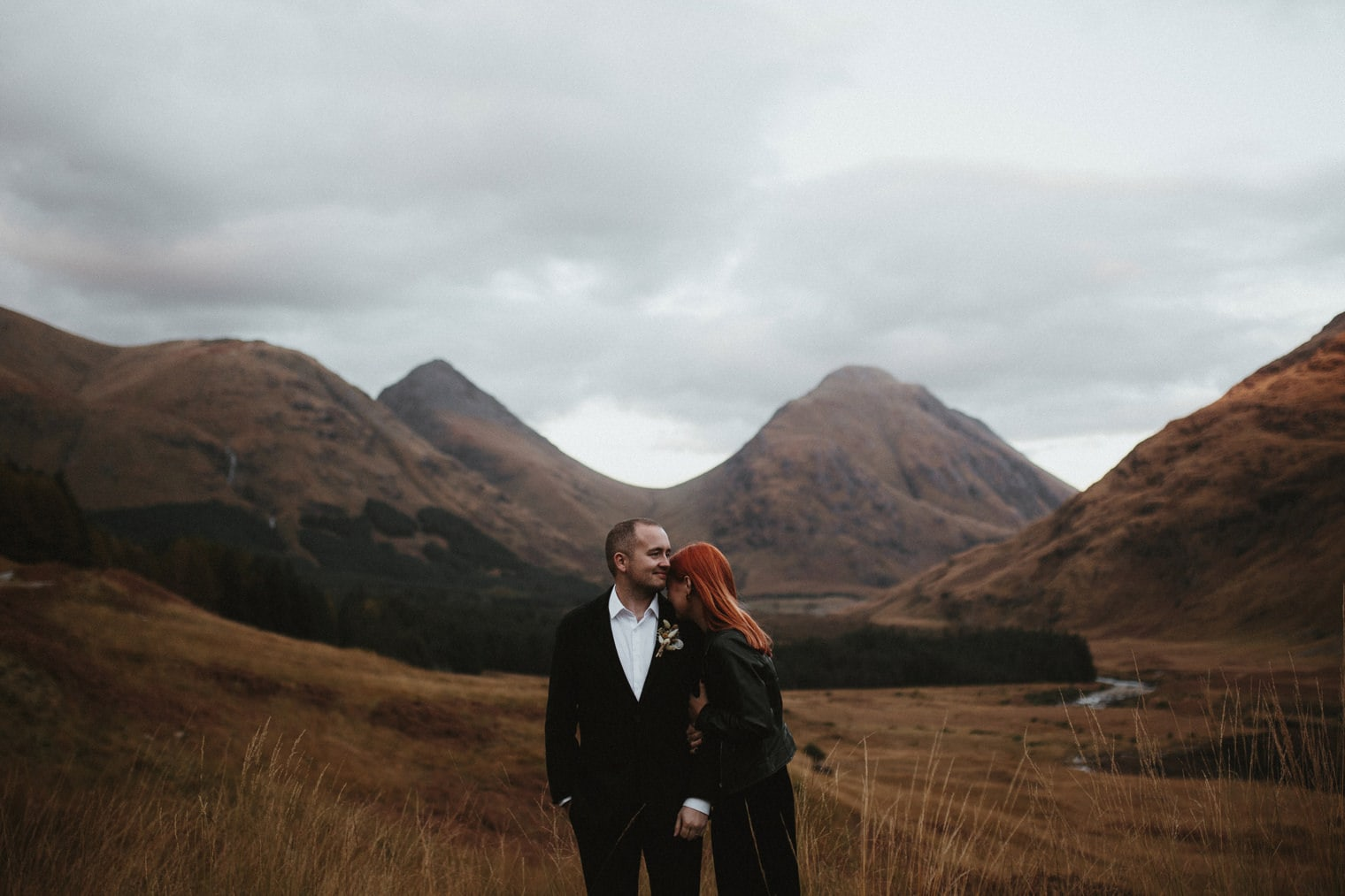 couple in glencoe during their autumn elopement in the scottish highlands