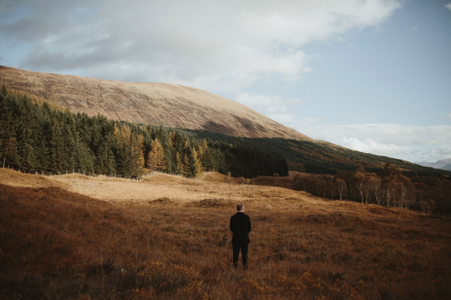 Groom waiting for first look in the Scottish Highlands