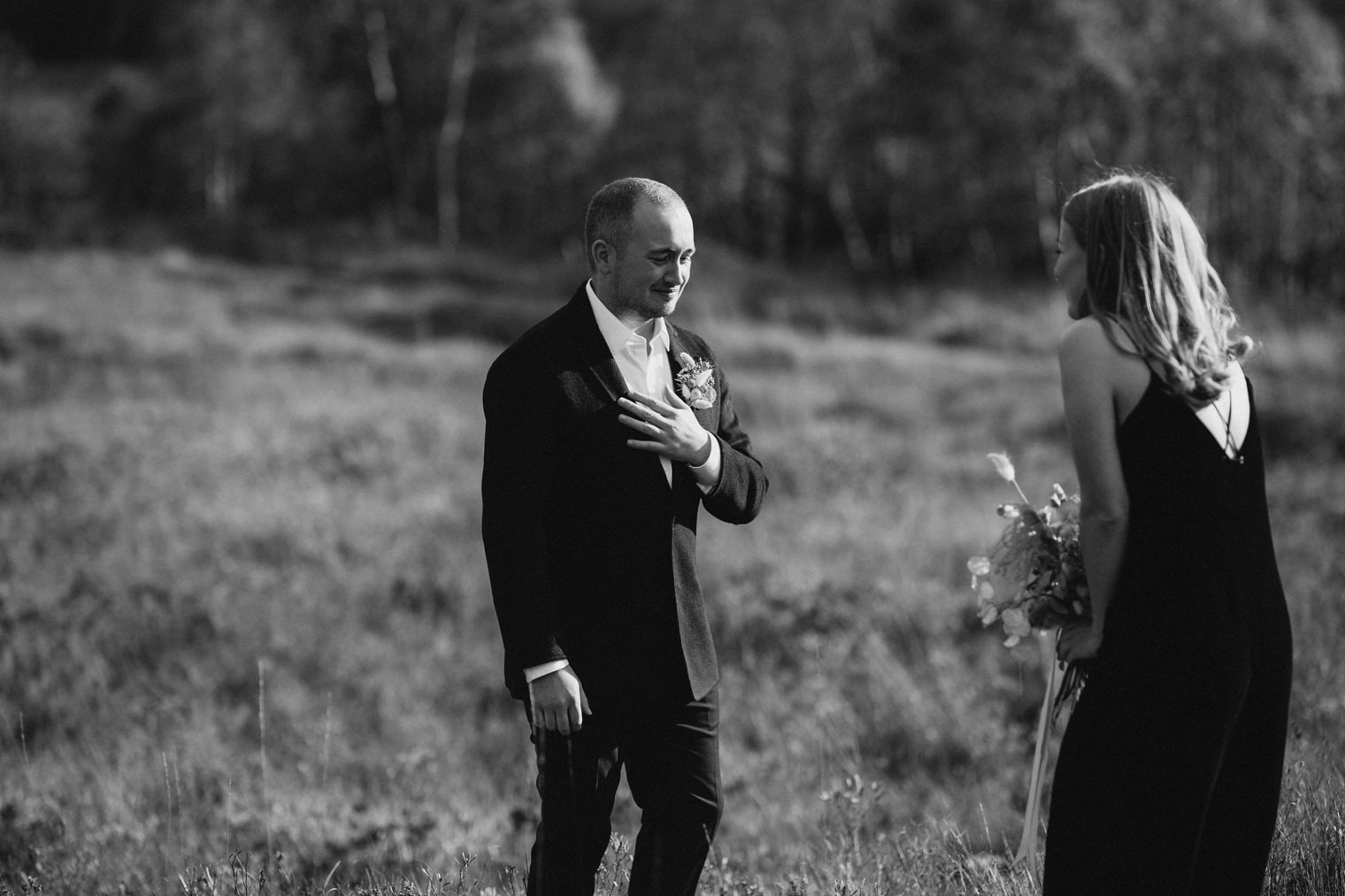 Emotional first look with bride and groom ahead of their autumn elopement in the scottish highlands