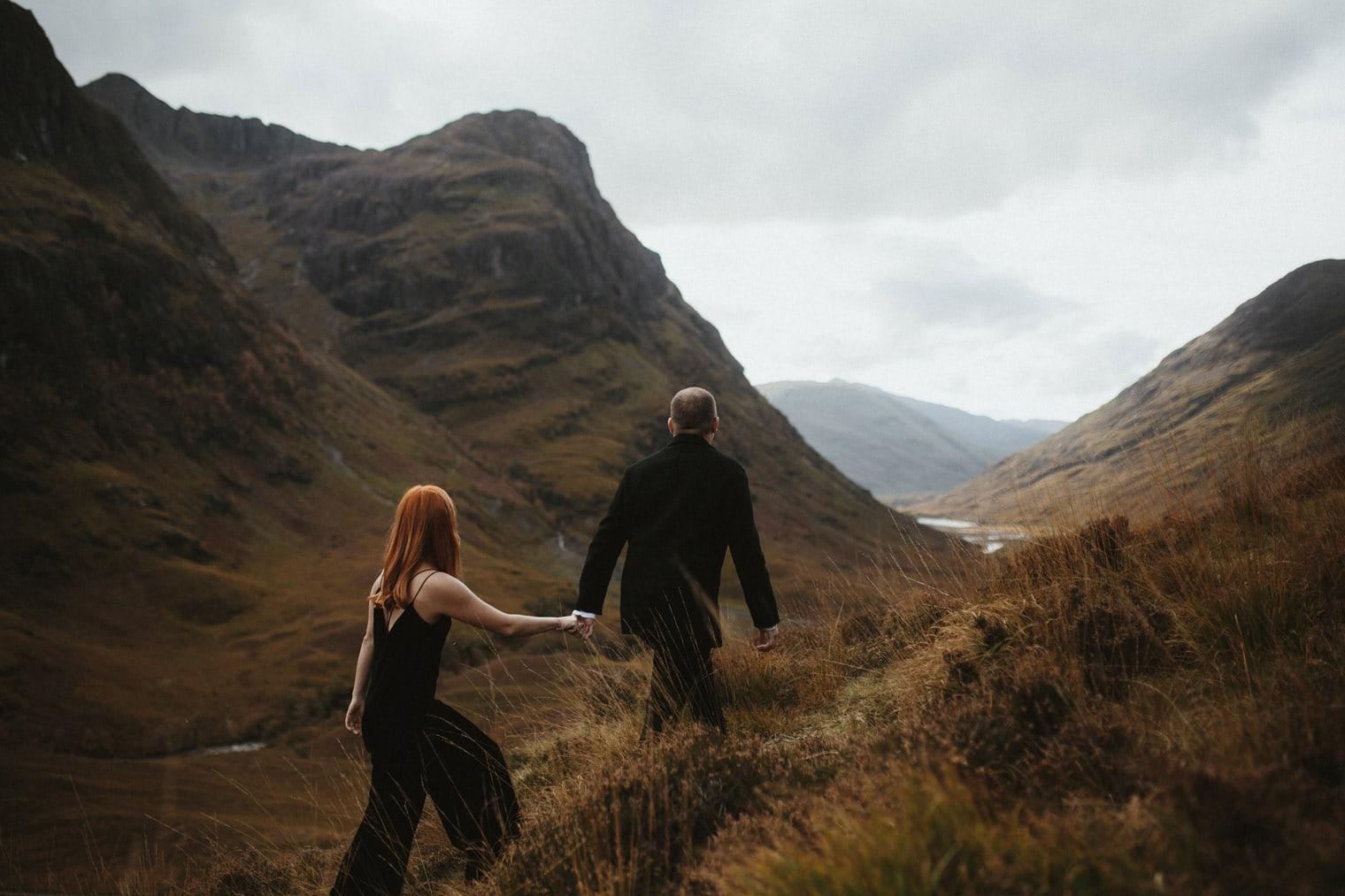Bride and groom exploring glencoe during their scottish highlands elopement