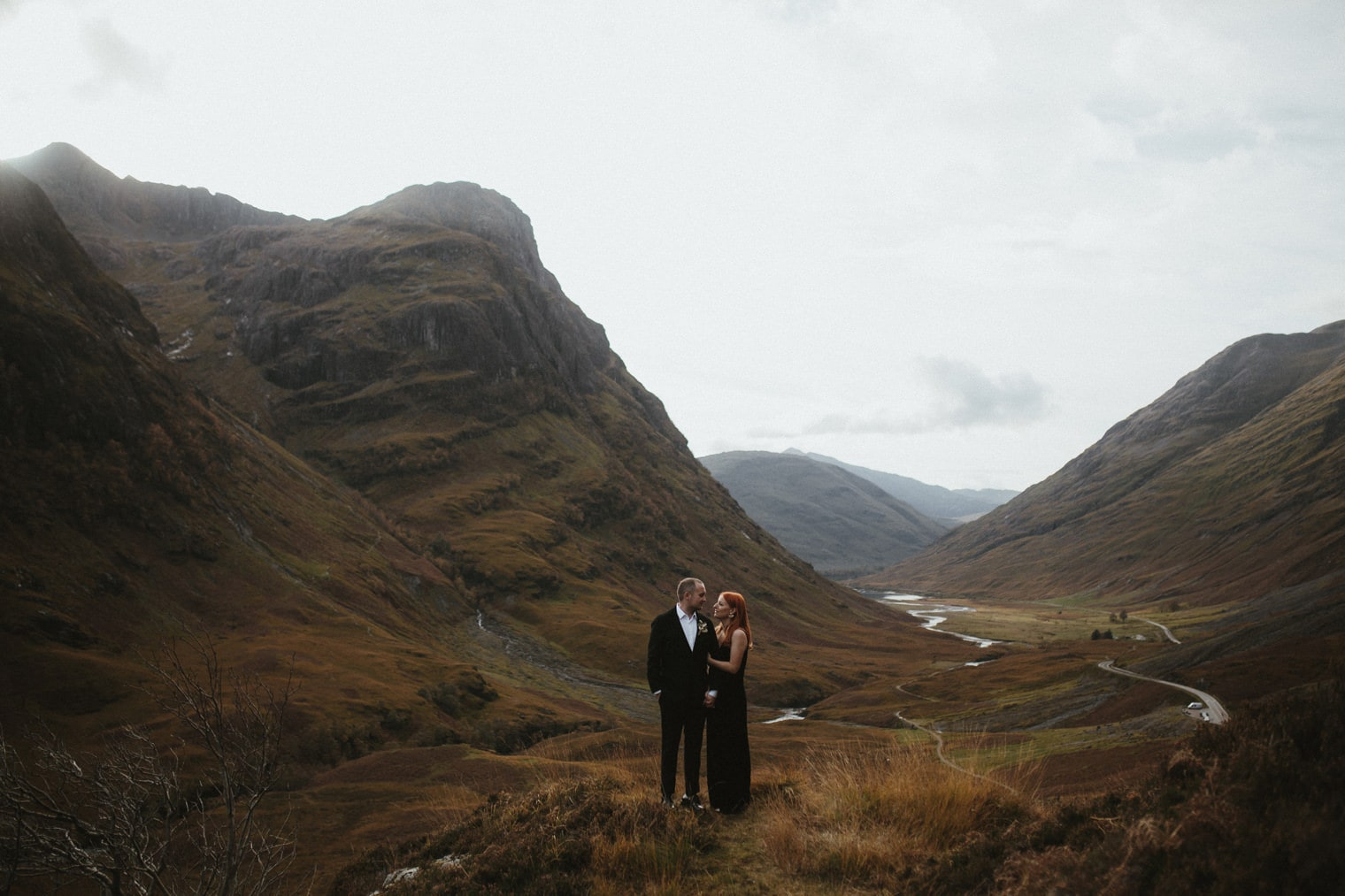 Newlyweds standing on top of Three Sisters lookout in Glencoe during their portrait session for their glencoe elopement