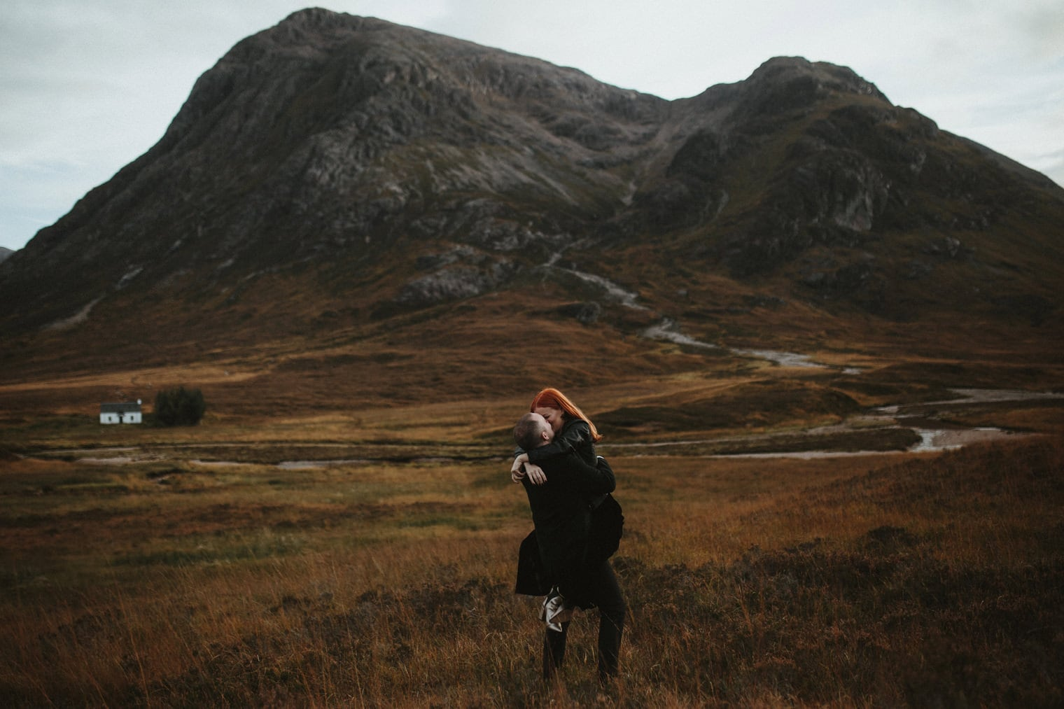 groom lifting up bride during their elopement in glencoe