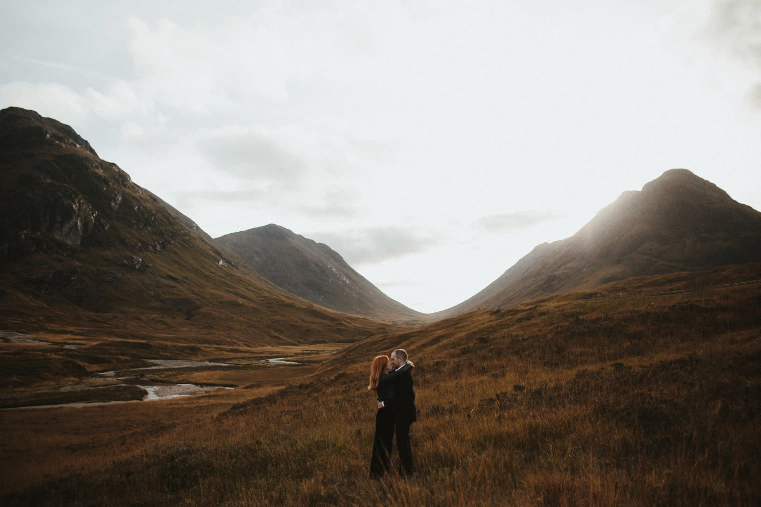 Couple in the scottish highlands during their autumn elopement