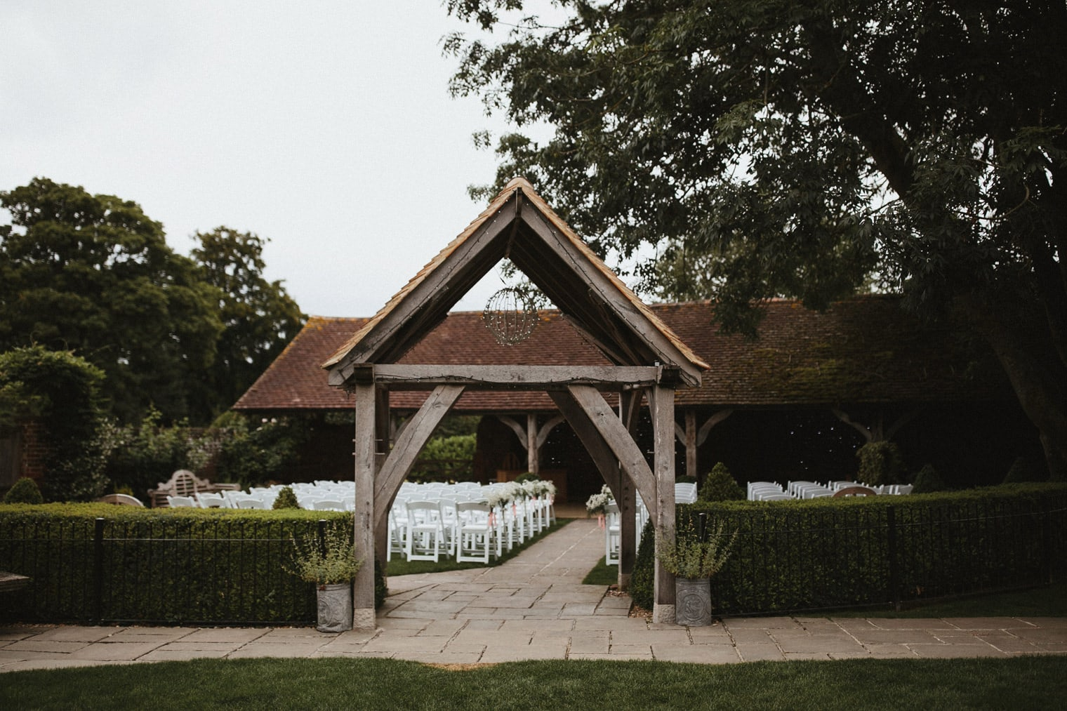 Outdoor English barn wedding ceremony