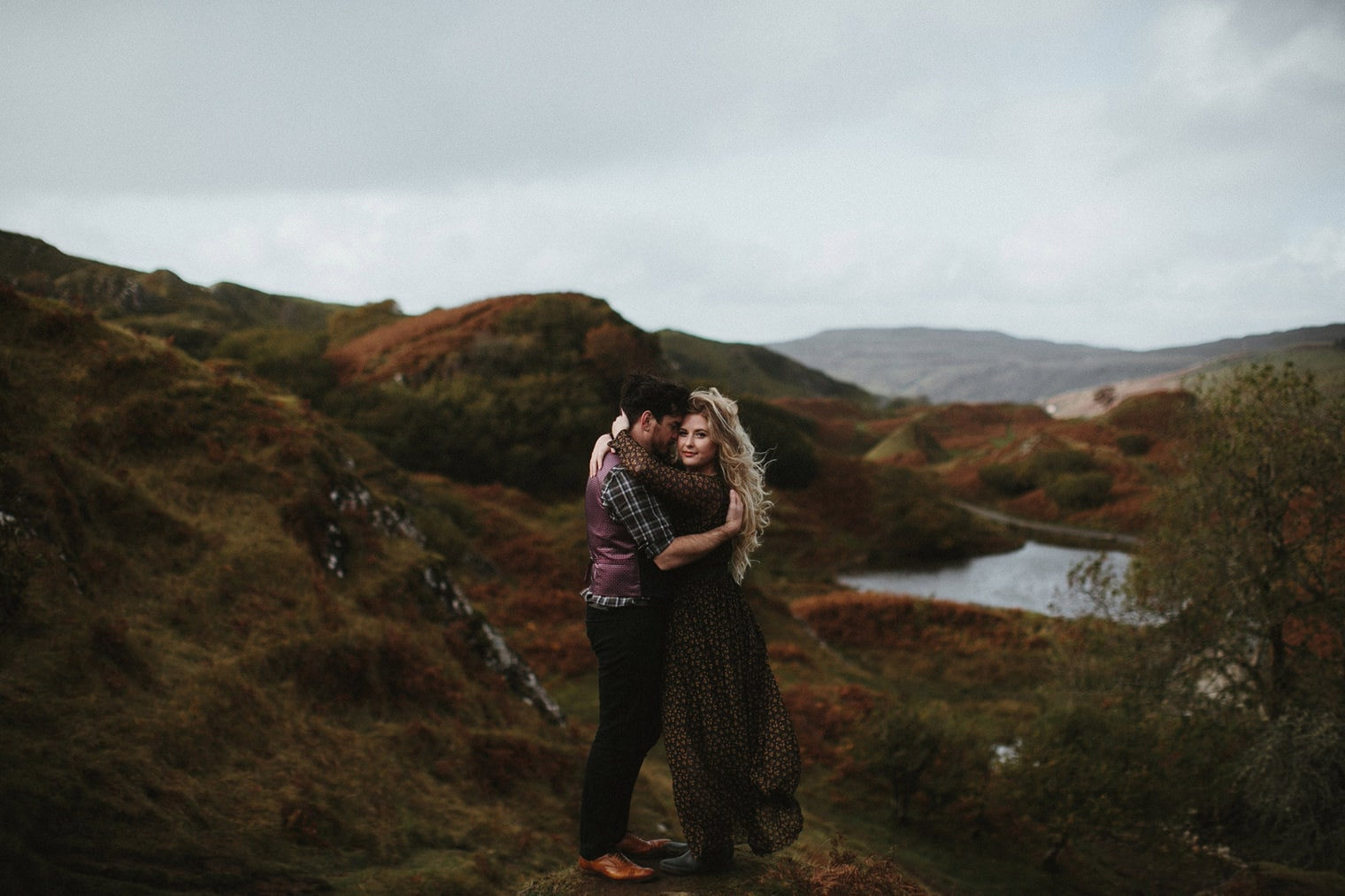 Couple hugging at The Fairy Glen during an anniversary session in Isle of Skye
