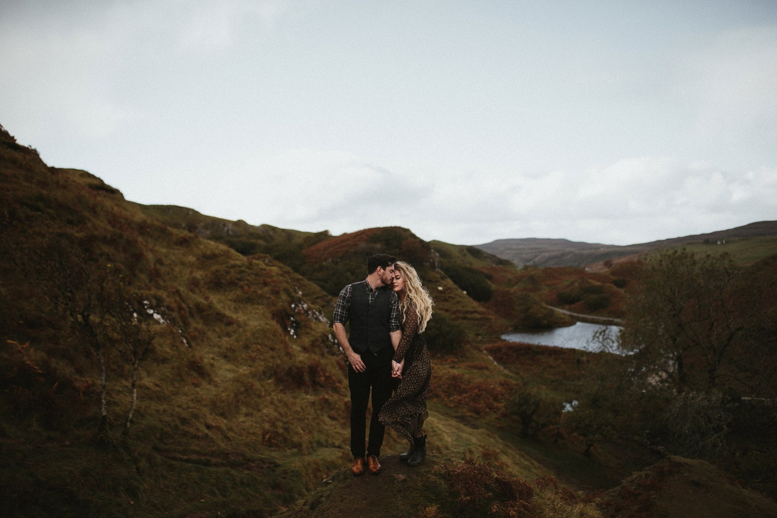 Couple standing together in The fairy glen during photoshoot for their anniversary