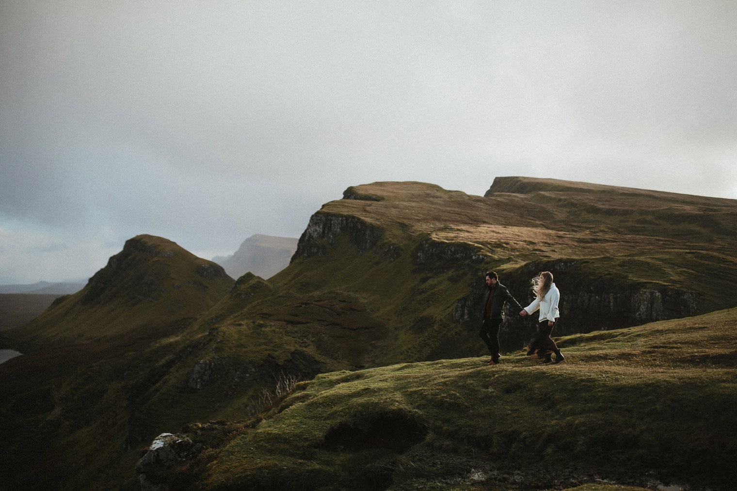 Couple walking out along the Quiraing in Isle of Skye during their anniversary shoot
