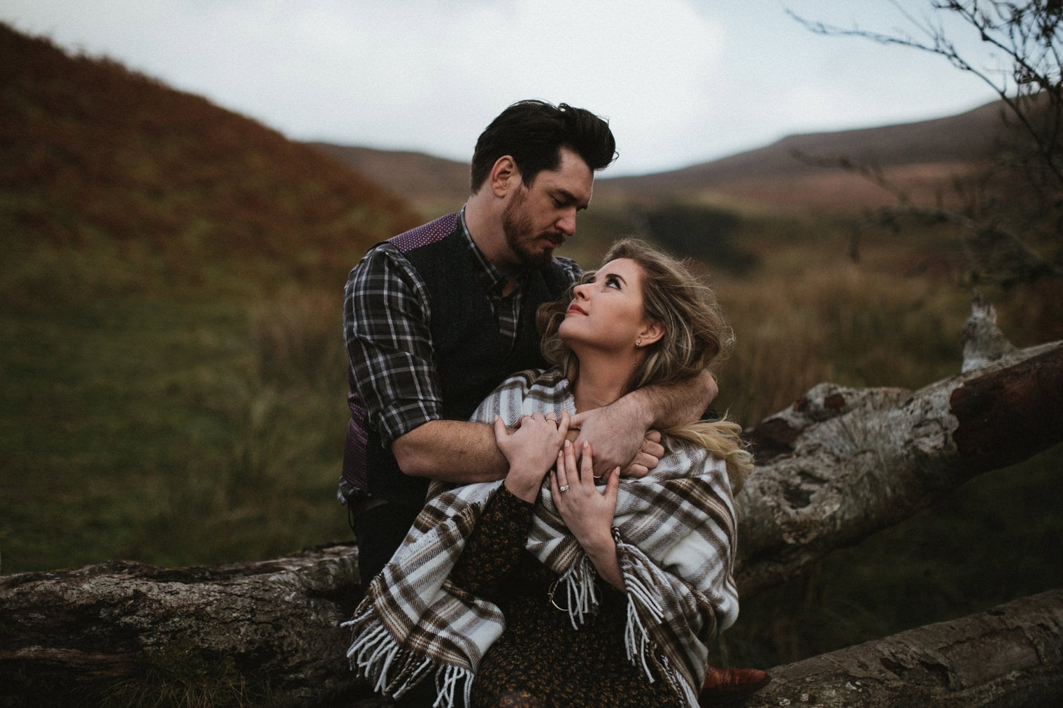 Couple hugging each other in the fairy glen in Scotland while having an isle of skye anniversary session
