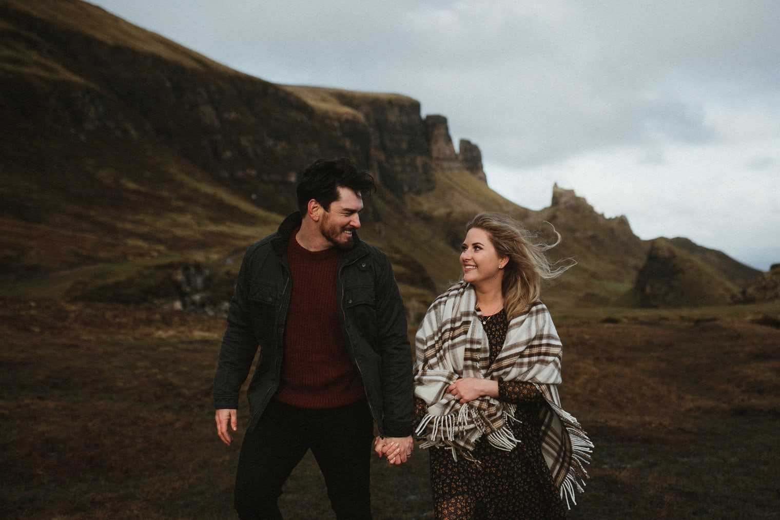 couple walking together during isle of skye adventure session at the Quiraing in Isle of Skye