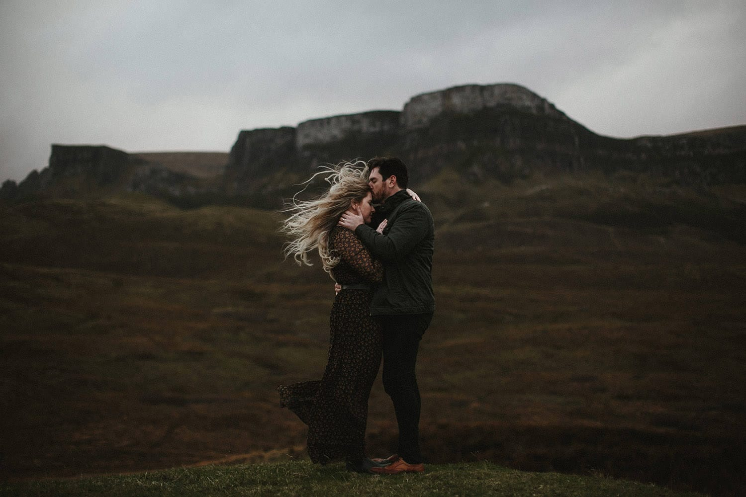 Man kissing woman on forehead during adventure anniversary in Isle of Skye