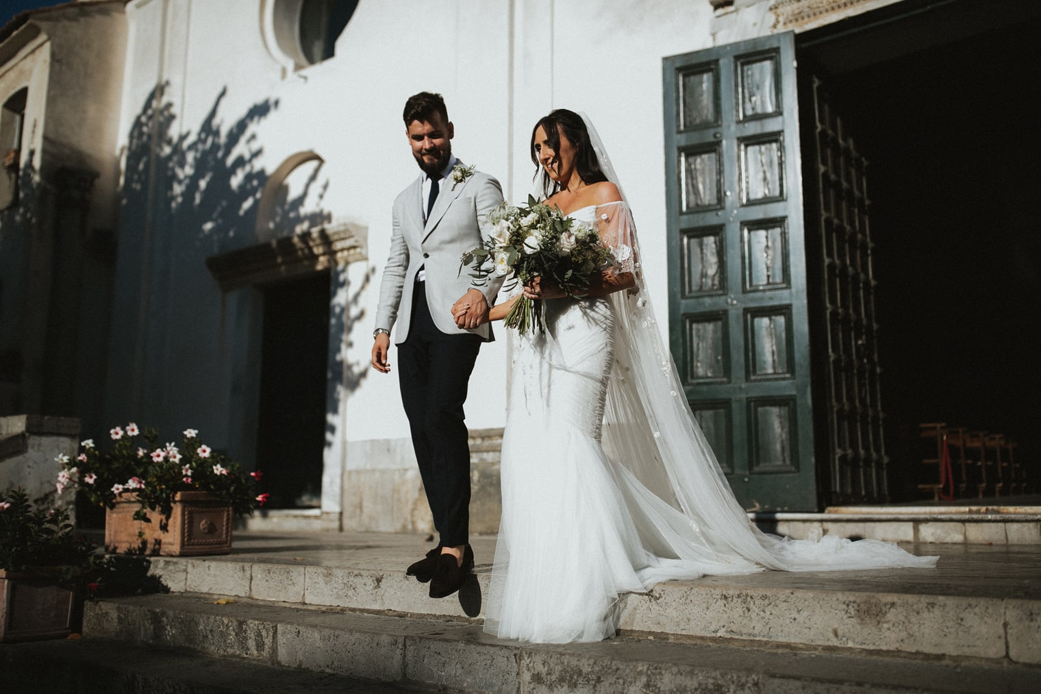 Bride and Groom outside Ravello Duomo after their wedding ceremony in Amalfi Coast