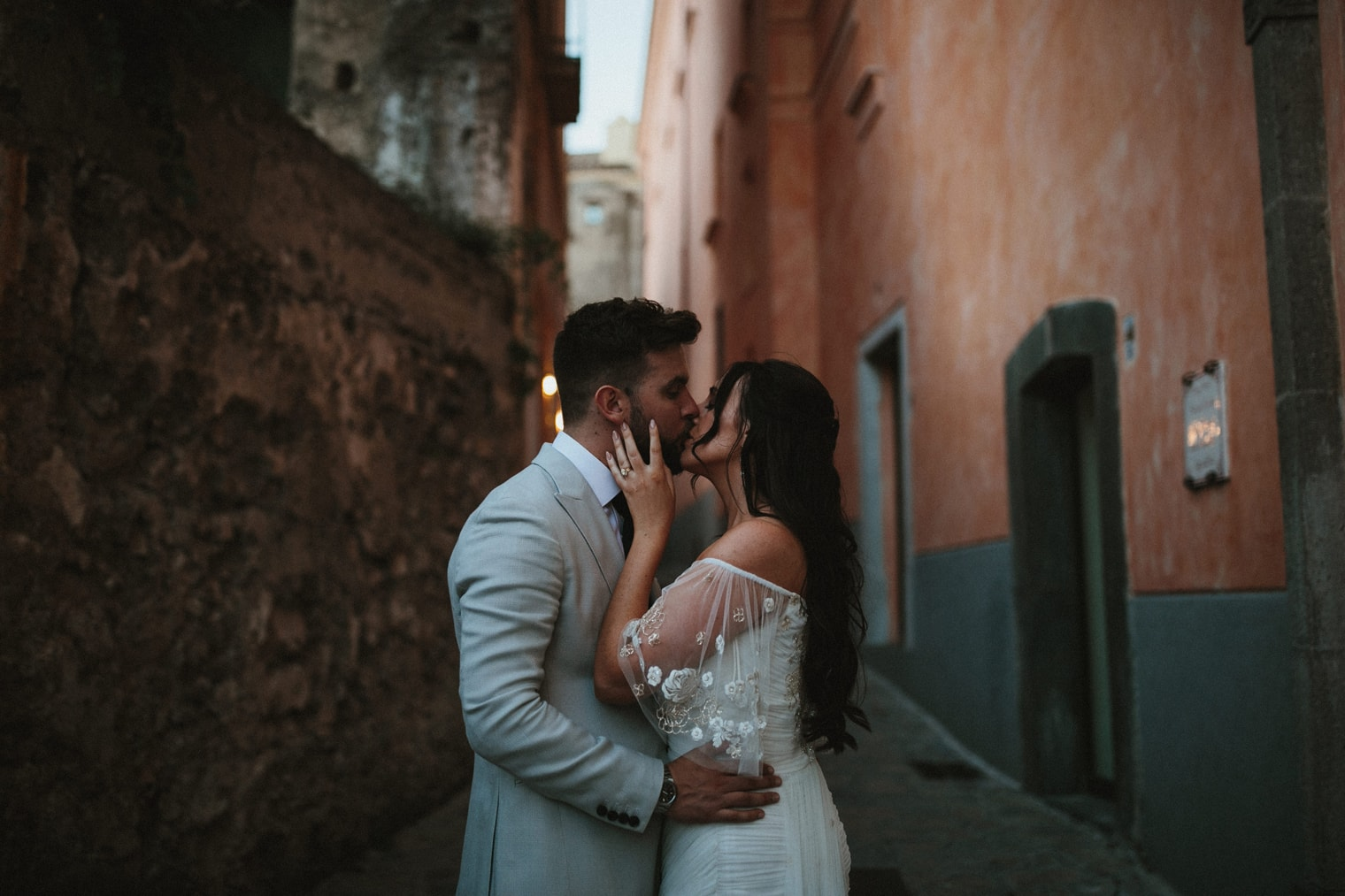 Bride and Groom kissing in the streets of Ravello, Italy