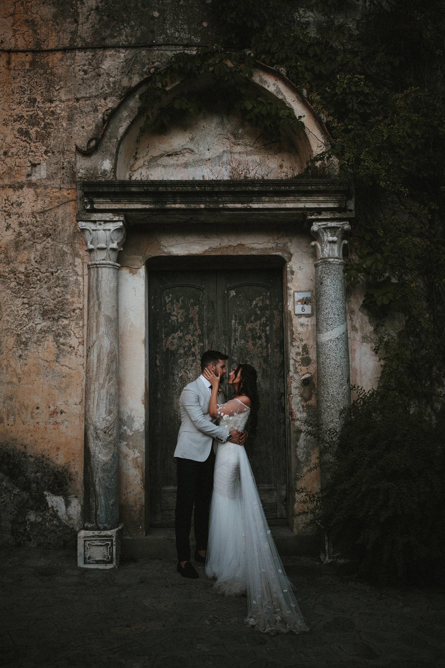 Bride and Groom in doorway in Ravello, Italy during their Amalfi coast wedding