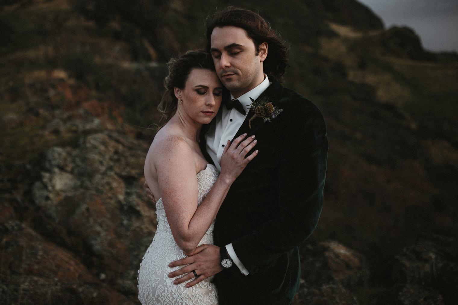 bride and groom in holyrood park in Edinburgh
