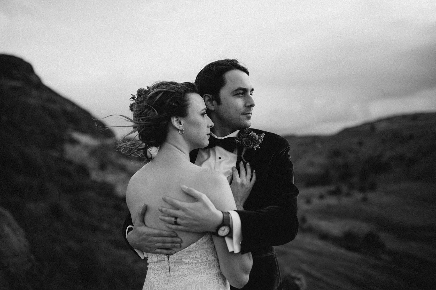 Bride and groom bracing the windy in Edinburgh during their edinburgh elopement
