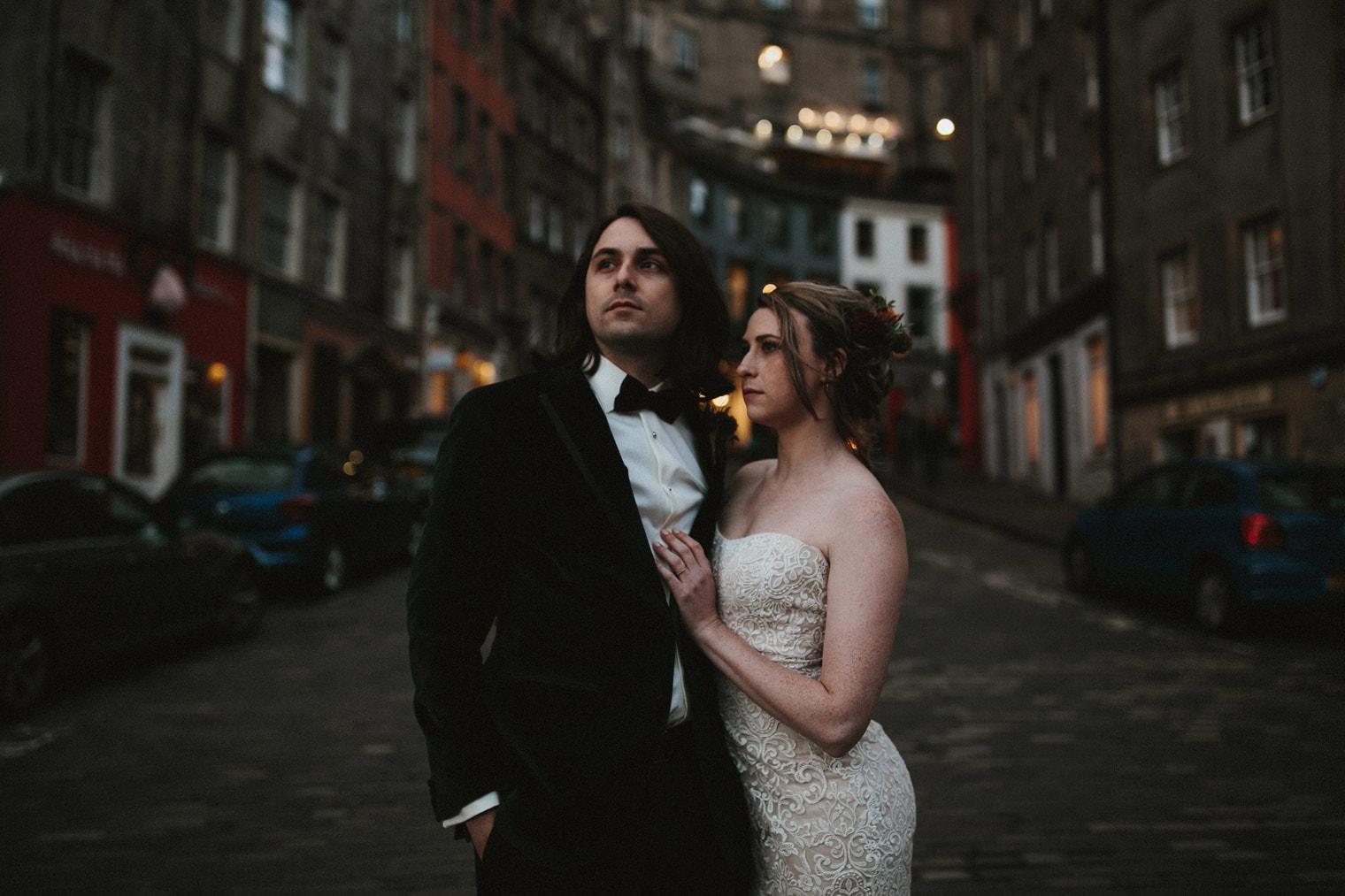 Bride and Groom during their Edinburgh Elopement standing in Victoria Street
