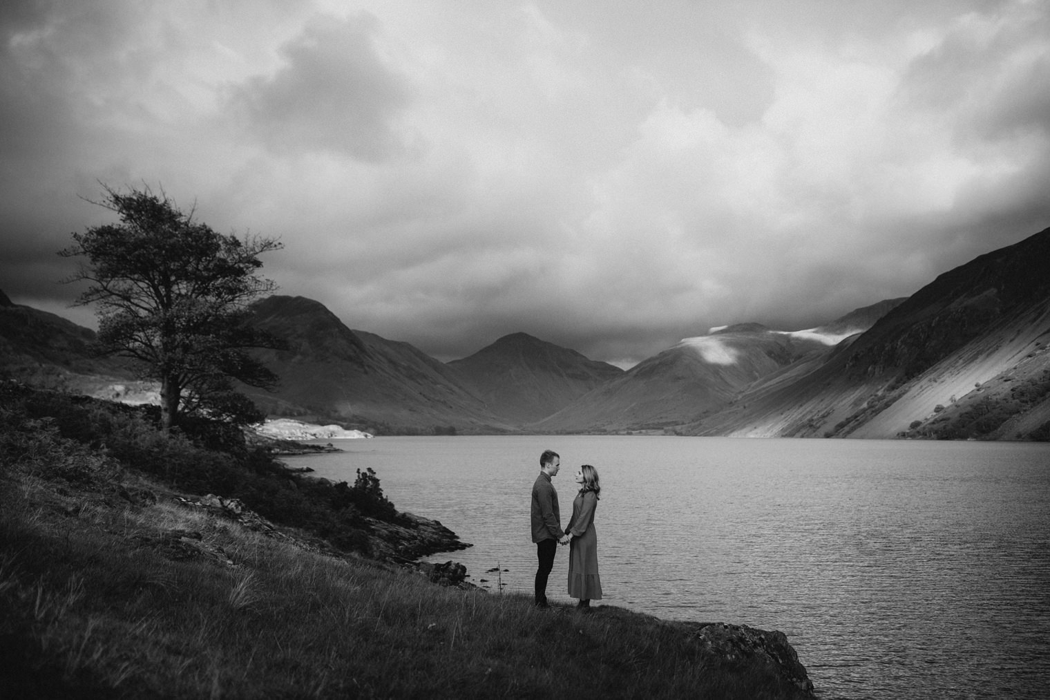 Stunning backdrop of a lake during a Couples Portrait Session in the Lake District