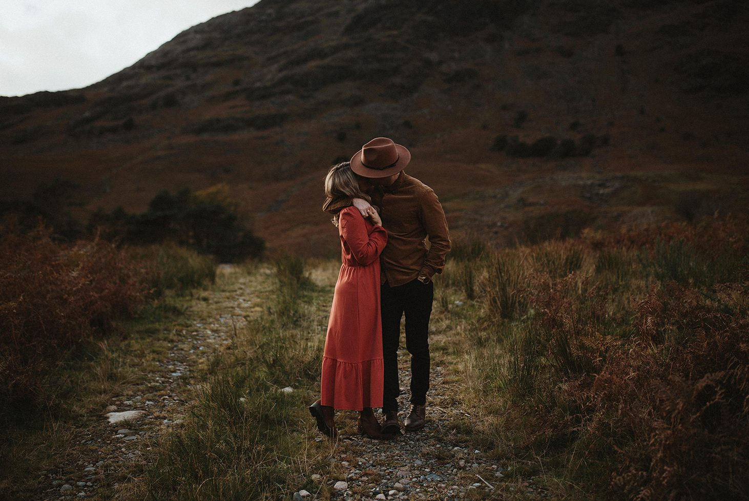 stylish couple kissing in the lake district.