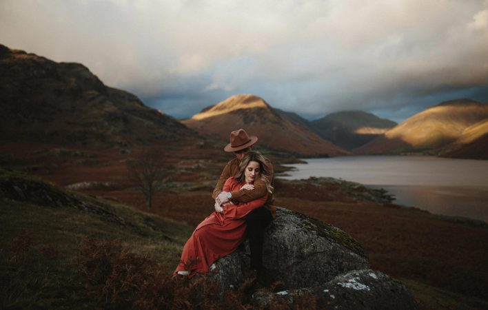 Couple embracing in the Lake District during their Lake district engagement shoot