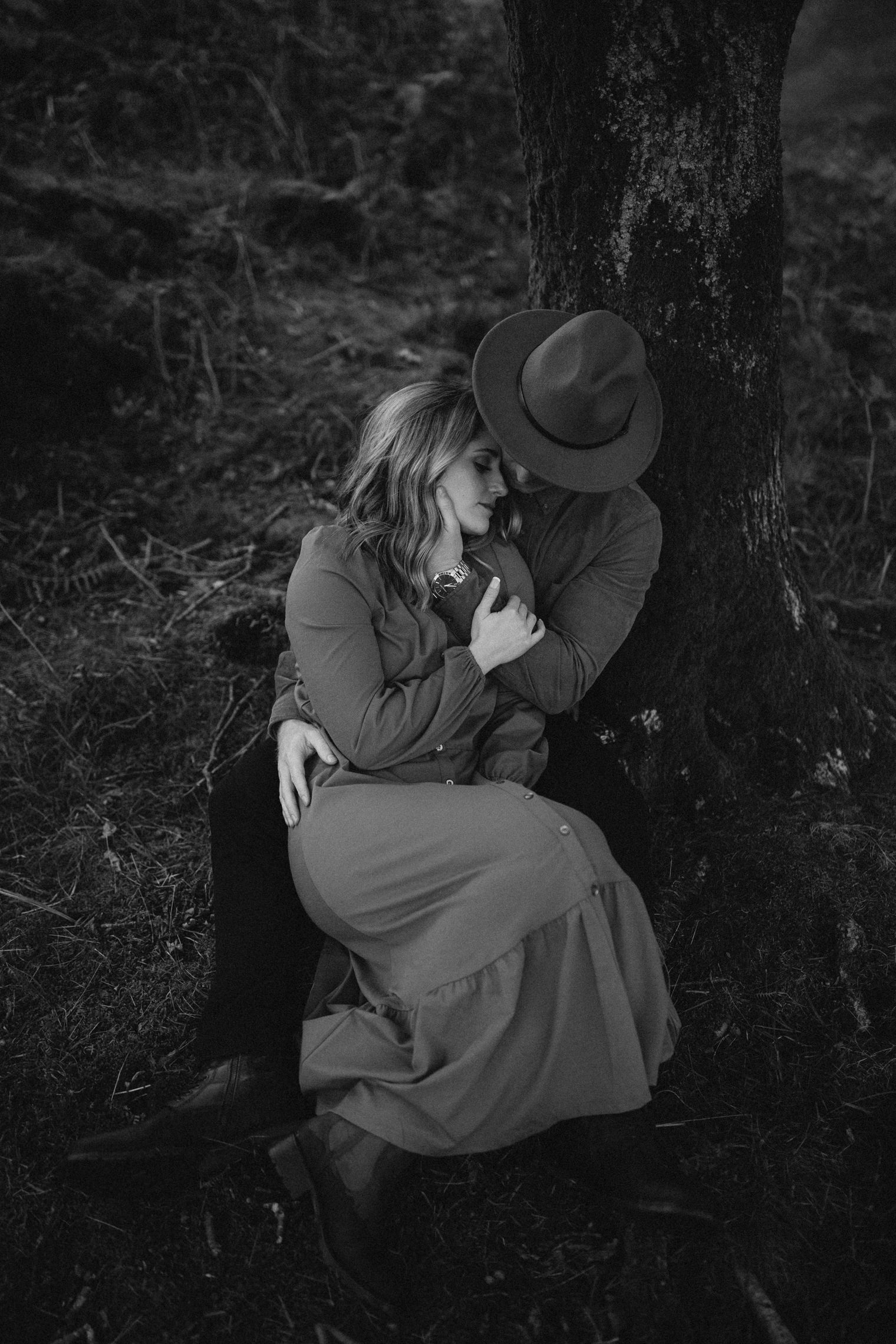 Couple embrace under a tree in the Lake District during their Couples Portrait Session
