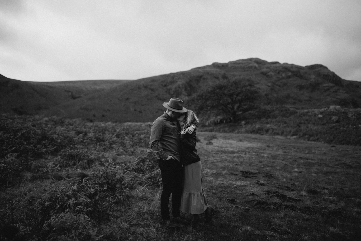 Couple kissing in the lake district during their engagement session